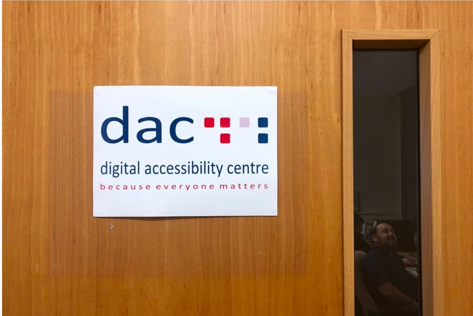 Photograph of a door with the DAC logo